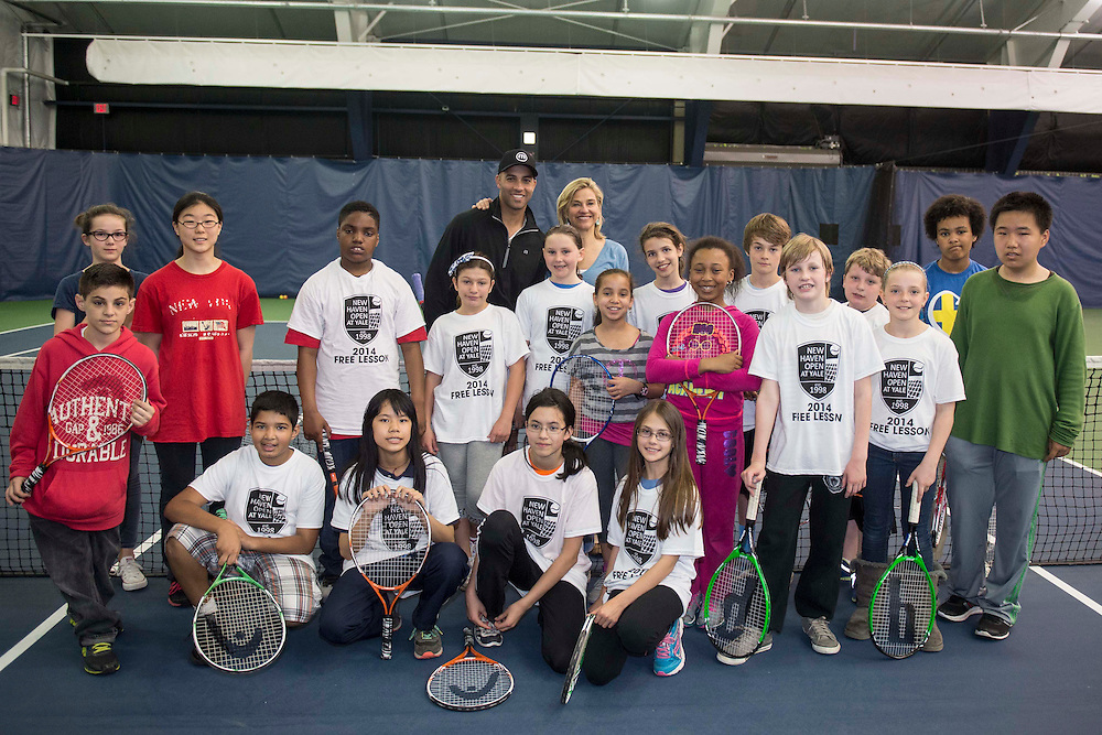 May 15, 2014, New Haven, Connecticut:<br /> Former professional tennis player James Blake and Tournament Director Anne Worcester pose with kids during a free tennis lesson and clinic Thursday, May 15, 2014 in advance of the 2014 New Haven Open at the Yale University Tennis Center in New Haven, Connecticut. <br /> (Photo by Billie Weiss/New Haven Open)