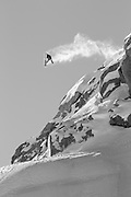 A black and white image of Pro boarder Rusty Ockenden hitting a famous Whistler Backcountry jump called 'Mother'. This classic snowboard spot is located on the Pemberton Ice Cap, North of Whistler, BC