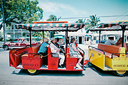 Tourists are being bused around in an open trolley. Key West on the southern-most tip of Florida is a popular tourist destination, with a very different vibe to it than Miami.