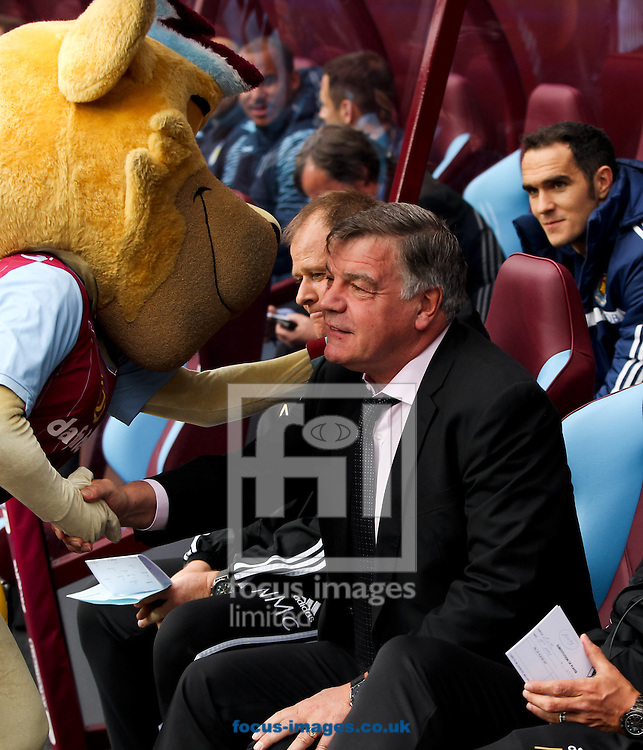 West Ham United manager Sam Allardyce is greeted by the Aston Villa mascot before the Barclays Premier League match at Villa Park, Birmingham<br /> Picture by Tom Smith/Focus Images Ltd 07545141164<br /> 09/05/2015