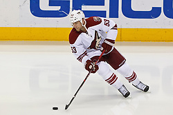 Mar 24, 2012; San Jose, CA, USA; Phoenix Coyotes defenseman Derek Morris (53) warms up before the game against the San Jose Sharks at HP Pavilion.  San Jose defeated Phoenix 4-3 in shootouts. Mandatory Credit: Jason O. Watson-US PRESSWIRE