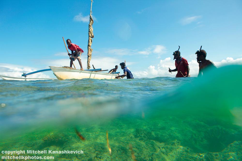 Ni Vanuatu boys fishing by the reef. Uleveo, Maskelyne Island, Malampa Province, Malekula, Vanuatu