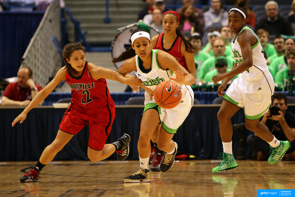 Skylar Diggins, Notre Dame, in action against Jude Schimmel, Louisville (left) during the Notre Dame Fighting Irish V Louisville Cardinals Semi Final match during the Big East Conference, 2013 Women's Basketball Championships at the XL Center, Hartford, Connecticut, USA. 11th March. Photo Tim Clayton