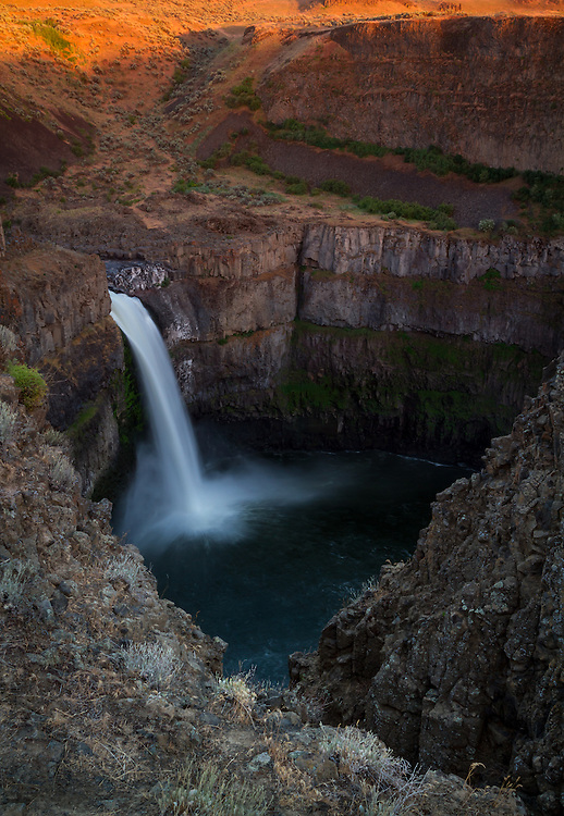 Palouse Falls in Palouse Falls State Park in Eastern Washington cascades into a massive gorge in the earth.