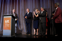 (L-R) Actor Bill Murray with popcorn and red liquorice in pocket, director ROGER MICHELL, Actress LAURA LINNEY and OLIVIA WILLIAMS, Writer RICHARD NELSON, and Producers DAVID AUKIN and KEVIN LOADER on stage at the 'Hyde Park On Hudson' premiere during the 2012 Toronto International Film Festival at Roy Thomson Hall, September 10th. Photo by David Tabor/ i-Images.