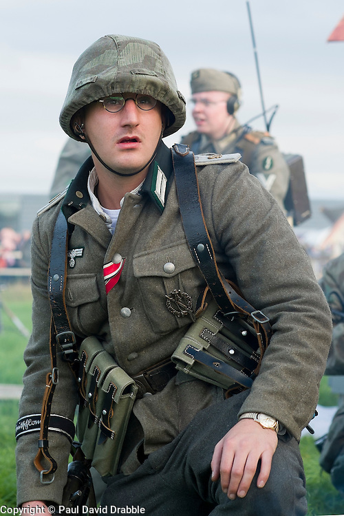 A Re-enactor portraying a  lieutenant in from Panzer Grenadier Division Grossdeutschland takes part in a battle battle re-enactment on Pickering Showground during the Pickering War Weekend<br />
