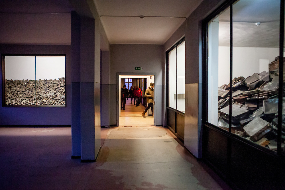 "Visitors at the general exhibition at Block 5 in the Auschwitz Nazi concentration camp showing ""evidence of a war crime"" with belongings of prisoners such as shoes, glasses and suitcases. It is estimated that between 1.1 and 1.5 million Jews, Poles, Roma and others were killed in Auschwitz during the Holocaust in between 1940-1945."