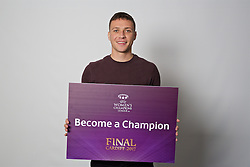 "CARDIFF, WALES - Monday, November 7, 2016: Wales' James Chester holds up a board ""Become a Champion"" to encourage people to become volunteers for the 2017 UEFA Champions League Final in Cardiff. (Pic by David Rawcliffe/Propaganda)"