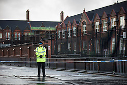 © Licensed to London News Pictures . 24/11/2015 . Liverpool , UK . Police carry out a fingertip search along Anfield Road outside Anfield Infant School where it's reported shots were fired this morning (24th November 2015) . Photo credit: Joel Goodman/LNP