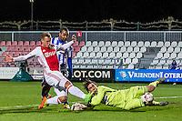 AMSTERDAM - Jong Ajax - FC Eindhoven , Voetbal , Jupiler league , Seizoen 2016/2017 , Sportpark de Toekomst , 24-02-2017 , Jong Ajax speler Kaj Sierhuis (l) in duel met Eindhoven keeper Ruud Swinkels (r) en Eindhoven speler Civard Sprockel (m)