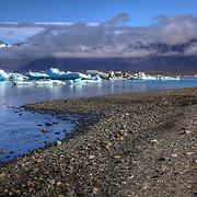 Jökulsárlón is a large glacial lagoon in southeast Iceland bordering Vatnajökull National Park. The lagoon is situated at the head of Breiðamerkurjökull glacier.