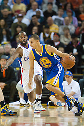 October 29, 2010; Oakland, CA, USA;  Golden State Warriors point guard Stephen Curry (30) dribbles past Los Angeles Clippers point guard Baron Davis (5) during the first quarter at Oracle Arena.