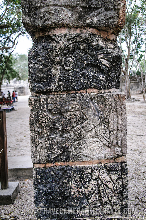 Carving of a Mayan warrior on a stone pillar at Chichen Itza Archeological Zone on Mexico's Yucatan Peninsula