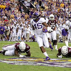 Oct 20, 2018; Baton Rouge, LA, USA; LSU Tigers linebacker Michael Divinity Jr. (45) run after a interception against the Mississippi State Bulldogs during the first quarter at Tiger Stadium. Mandatory Credit: Derick E. Hingle-USA TODAY Sports