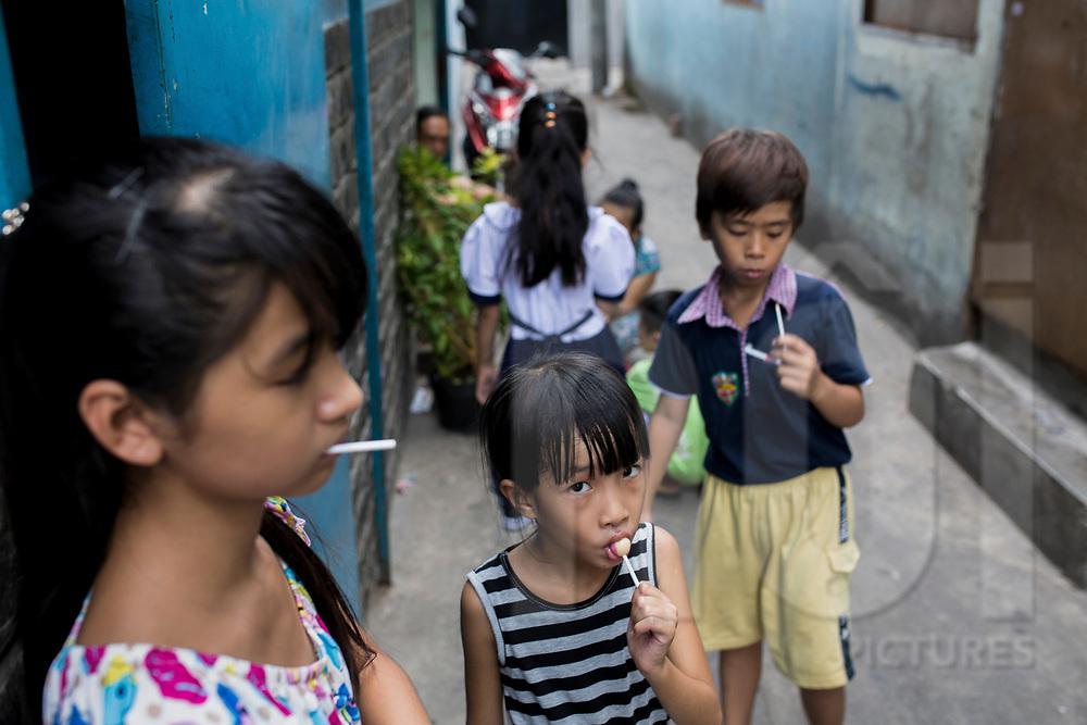 A group of Vietnamese children enjoy lollipop, Ho Chi Minh City, Vietnam, Southeast Asia