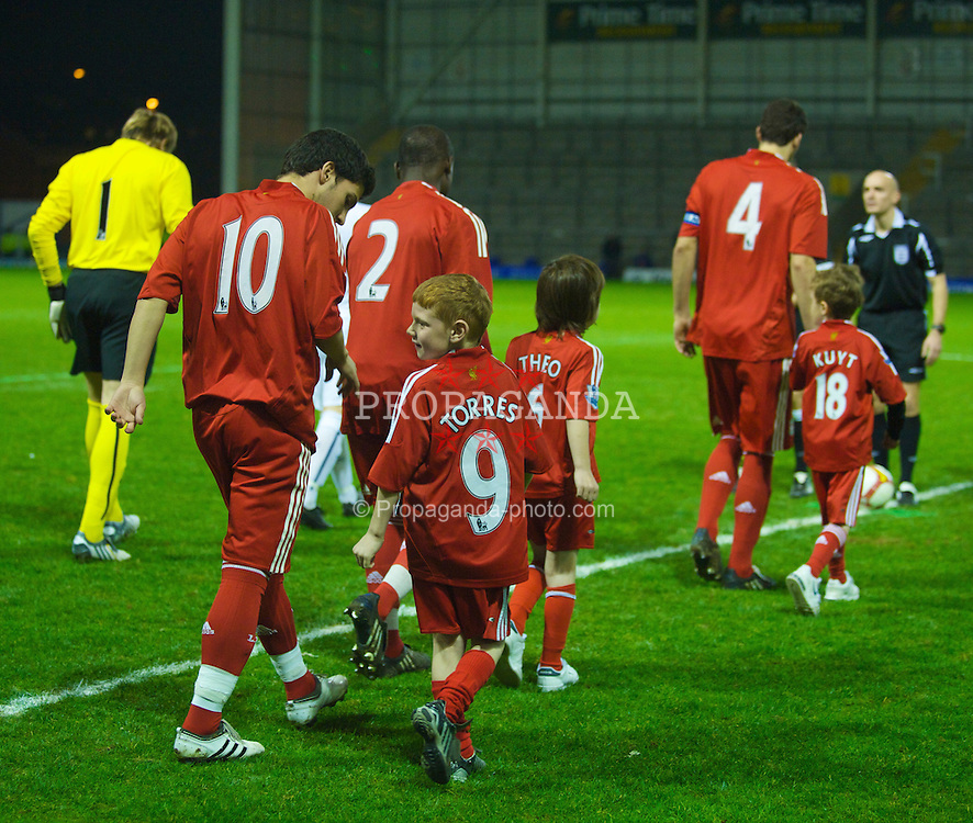 WARRINGTON, ENGLAND - Thursday, March 12, 2009: Liverpool players walk out with mascots before the FA Premiership Reserves League (Northern Division) match against Manchester United at the Halliwell Jones Stadium. (Photo by David Rawcliffe/Propaganda)