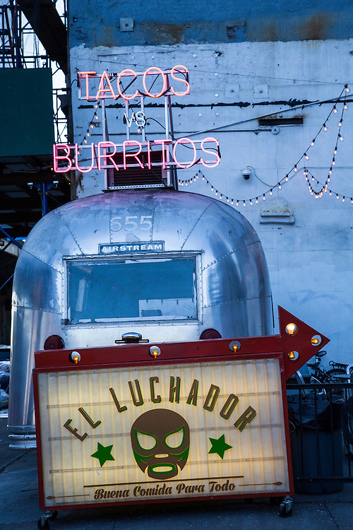 A retro silver airstream caravan converted into a Mexican street food cafe on South Side Street, Lower Manhattan, New York City, New York, United States of America. The neon sign above the caravan says Taco vs Burritos.  (photo by Andrew Aitchison / In pictures via Getty Images)