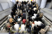 Commuters rush up and down a stairway at a major station in Tokyo, Japan.