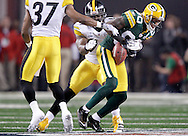 Green Bay Packers' Donald Driver is tackled by Pittsburgh Steelers' Lawrence Timmons after a 24-yard pass completion from Aaron Rodgers in the 1st quarter. .The Green Bay Packers played the Pittsburgh Steelers in Super Bowl XLV,  Sunday February 6, 2011 in Cowboys Stadium. Steve Apps-State Journal.