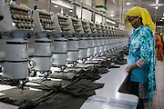 A garment worker at work on a machine inside  Epyllion Group garment factory in Bangladesh.