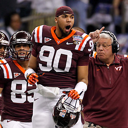January 3, 2012; New Orleans, LA, USA; Virginia Tech Hokies defensive end Duan Perez-Means (90) reacts from the bench during the first quarter of the Sugar Bowl against the Michigan Wolverines at the Mercedes-Benz Superdome.  Mandatory Credit: Derick E. Hingle-US PRESSWIRE