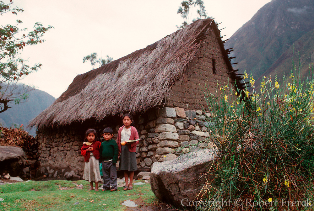 PERU, HIKING INCA TRAIL on the way to Machu Picchu, Quechua children in front of traditional home
