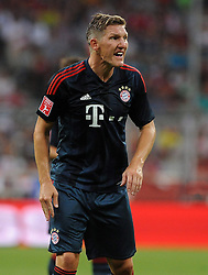 31.07.2013, Allianz Arena, Muenchen, Audi Cup 2013, FC Bayern Muenchen vs Sao Paulo, im Bild, Bastian SCHWEINSTEIGER (FC Bayern Muenchen) ist extrem unzufrieden. Einzelbild, angeschnitten, angeschnittenes einzelmotiv, halbfigur, halbe Figur, hochformat, vertikal, Aktion,  // during the Audi Cup 2013 match between FC Bayern Muenchen and Sao Paulon at the Allianz Arena, Munich, Germany on 2013/07/31. EXPA Pictures © 2013, PhotoCredit: EXPA/ Eibner/ Wolfgang Stuetzle<br /> <br /> ***** ATTENTION - OUT OF GER *****