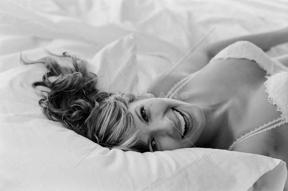 beautiful woman in bed wearing a lace bra