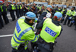 © Licensed to London News Pictures.  01/06/2013. LONDON, UK. Police arrest an anti-fascist protester after he refused to comply with police orders to disperse. Police were forced to separate rival protests by the BNP and anti-fascist groups in Whitehall. The BNP initially wanted to march in Woolwich, scene of the murder of a solider recently, but were banned by police from doing so.  Photo credit: Cliff Hide/LNP