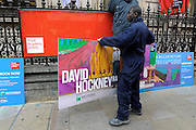 © Licensed to London News Pictures. 16/01/2012, London, UK. Workers hang posters advertising the David Hockney exhibition at the Royal Academy of Arts. In January 2012 the Royal Academy of Arts will showcase the first major exhibition of new landscape works by David Hockney RA. The exhibition which is expect to set records for attendence is on 21 January - 9 April 2012.  Photo credit : Stephen Simpson/LNP