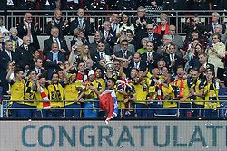 Arsenal Players celebrate as Arsenal's Mikel Arteta and Arsenal's Per Mertesacker lift the trophy - Photo mandatory by-line: Dougie Allward/JMP - Mobile: 07966 386802 - 30/05/2015 - SPORT - Football - London - Wembley Stadium - Arsenal v Aston Villa - FA Cup Final
