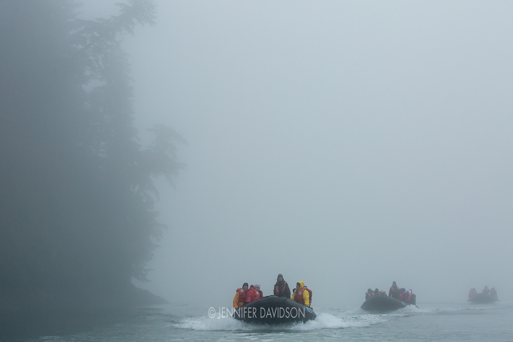 Guests from the National Geographic Sea Lion ride in small inflatable boats through the fog in La Conte Bay, near Petersburg, Alaska.