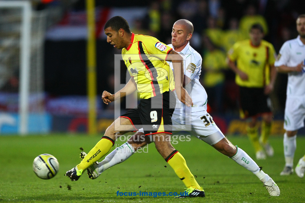 Watford - Tuesday April 12th, 2011: Marc Tierney of Norwich and Troy Deeney of Watford in action during the Npower Championship match at Vicarage Road, Watford. (Pic by Paul Chesterton/Focus Images)