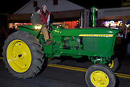 Pine Bush, New York - Tractors drive down Main Street during the Community Country Christmas presented by the Pine Bush Chamber of Commerce on Dec. 1, 2012.