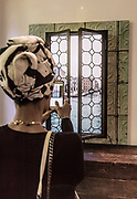 Milan, Helene Nonini photographing Anotherview N°5, Carnival from Palazzo Pisani.Gallery Rossana Orlandi was opened in 2002 in a former tie Factory in the Magenta neighbor , Galleria Rossana Orlandi has been forecasting along the years new and upcoming designers and establishing the premise as one of the most revered platform for avant-garde Design and Lifestyle. Started her activity focusing on the rising dutch design wave with designers such Piet Hein Eek, Maarten Baas and Nacho Carbonell the research has moved widely around the world creating a catalog which reflects the most innovative scenes from Europe to Asia to America.<br /> The space is articulated in a not traditional way mixing together, showroom, a retail store, offices and a courtyard for events and meeting with no boundaries between the different activities.<br /> Galleria Rossana Orlandi has also revolutionized the way to present design art pieces, showing them always in real ambiances, displayed together with different kind of products to recreate real houses situations and, taking advantage of the structure of the gallery itself composed by different rooms on different floor, all winding around a blooming courtyard.<br /> The Space itself also became a perfect locations for corporate and cultural events with different possibilities in terms of ambiances, installations and contents. pho