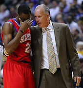 April 21, 2012; Indianapolis, IN, USA; Philadelphia 76ers head coach Doug Collins talks to Philadelphia 76ers forward Thaddeus Young (21) during a timeout against the Indiana Pacers at Bankers Life Fieldhouse. Philadelphia defeated Indiana 109-106. Mandatory credit: Michael Hickey-US PRESSWIRE