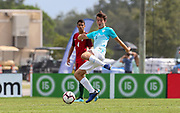 Slovenia defender Nik Zrnec (6) receives a pass in a game against Portugal during a CONCACAF boys under-15 championship soccer game, Sunday, August 11, 2019, in Bradenton, Fla. Portugal defeated Slovenia in the final in 2-0. (Kim Hukari/Image of Sport)