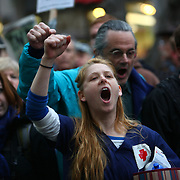 Protesters chant as people are arrested during the Occupy Seattle protest at Westlake Park on Wednesday, October 5, 2011 in Seattle. The protest mirrored the Occupy Wall Street protest in New York. Protesters were ordered to remove their encampment from the park, leading to arrests of people that refused to move. (Joshua Trujillo, seattlepi.com)