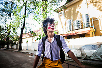 Circus performers make their way through the streets of Siem Reap, Cambodia, for an afternoon public performance.