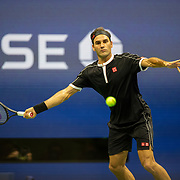 2019 US Open Tennis Tournament- Day Nine.  Roger Federer of Switzerland in action against Grigor Dimitrov of Bulgaria in the Men's Singles Quarter-Finals match on Arthur Ashe Stadium during the 2019 US Open Tennis Tournament at the USTA Billie Jean King National Tennis Center on September 3rd, 2019 in Flushing, Queens, New York City.  (Photo by Tim Clayton/Corbis via Getty Images)