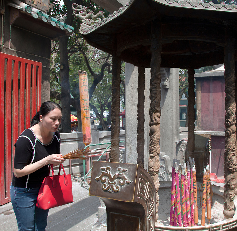 Burning joss sticks, A-Ma Temple, Macau, China.   The A-Ma Temple is a temple to the Chinese sea-goddess Mazu and is located on Barra Hill in São Lourenço, Macau, China. Built in 1488, the temple is one of the oldest in Macau and thought to be the source of the settlement's name.  It is part of the Historic Centre of Macau, a UNESCO World Heritage Site.