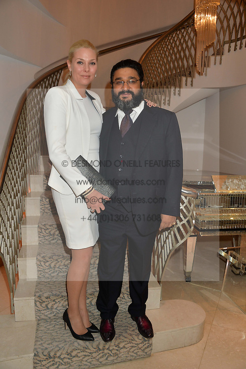 The HON.ANGAD PAUL and his wife MICHELLE PAUL at the Fortune Forum Club dinner in the presence of HSH Prince Albert II of Monaco held at The Dorchester, Park Lane, London on 15th January 2014.