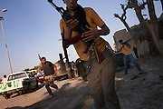 Rebels on the frontline in Bab Al Azizia, the Qaddafi stronghold.
