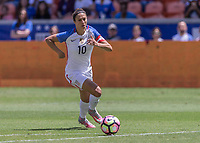 HOUSTON, TX - APRIL 09: Carli Lloyd (10) midfielder of U.S. advances the ball during the soccer match between Russia and USA on April 9, 2017 at BBVA Compass Stadium in Houston, Texas<br /> Norway only