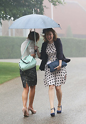 Not so Glorious Goodwood… Two racegoers get caught up in torrential rainfall at the opening day of Glorious Goodwood in the UK, Tuesday, 30th July 2013 <br /> Picture by Stephen Lock / i-Images