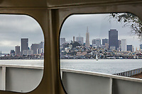 San Fransico through the windows of the Alcatraz Ferry boat docked on Alcatraz Island, San Fransisco Bay, California, USA.