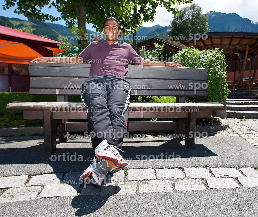 31.07.2010, Europaplatz, Kaprun, AUT, Rubin Okotie im Portrait, im Bild Rubin Okotie (1. FC Nürnberg, # 26), österreichischer Nationalspieler beim Relaxen, EXPA Pictures © 2010, PhotoCredit: EXPA/ J. Feichter / SPORTIDA PHOTO AGENCY