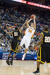 Tennessee Volunteers forward Ryan Childress (34) shoots over Long Beach State 49ers center Mark Dawson (21).  The #5 seed Tennessee Volunteers defeated the #12 seed Long Beach State 49ers 121-86  in the first round of the Men's NCAA Tournament in Columbus, OH on March 16, 2007.