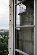 castle window reflecting the balcony with landscape view