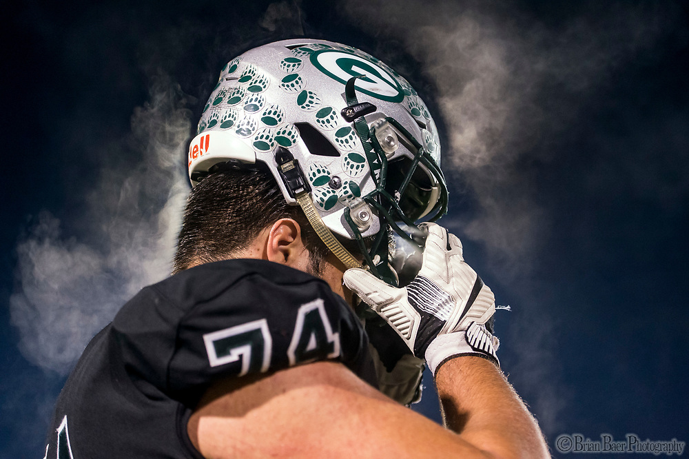 Steam comes off the head of Granite Bay Grizzly's Will Craig (74), near the end of the game as the Granite Bay Grizzlies varsity football team fall 37-14 to the Pittsburg Pirates football team in the CIF NorCal Division I-A title game, Saturday Dec 9, 2017. <br /> photo by Brian Baer